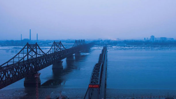 North Korea is seen across the Yalu River from the Chinese port city of Dandong, Feb. 8, 2017.