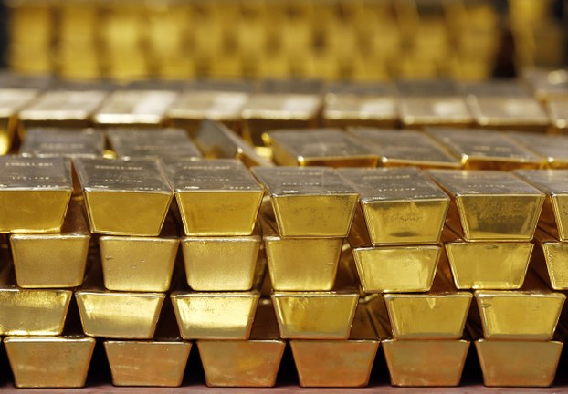 In this file photo, gold bars are stacked in a vault at the United States Mint, in West Point, N.Y.
