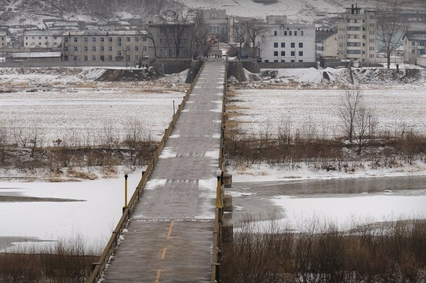 The town of Namyang in North Korea's North Hamgyong province is seen across the Tumen River from the town of Tumen in China's Jilin province, in a file photo.