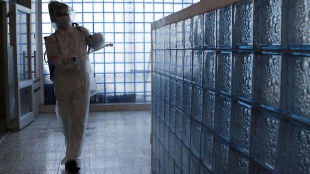 An employee wearing a protective gear disinfects to help curb the spread of the coronavirus at the Ryugyong Health Complex's public bath in Pyongyang, North Korea, Friday, July 31, 2020.