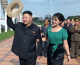 North Korean leader Kim Jong Un (l) with his wife Ri Sol Ju (r) touring a park in Pyongyang in an undated photo released by the Korean Central News Agency on July 26, 2012.