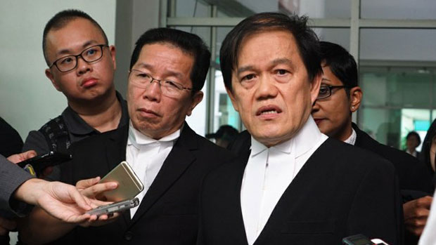 Defense lawyers Hisyam Teh Poh Teik (right), and Gooi Soon Seng speak to reporters following a court session in the Kim Jong Nam murder case, in Shah Alam, Malaysia, June 27,2018.
