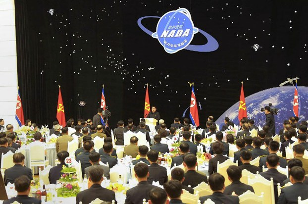 North Korean state media photo of Kim Jong-Un (C) giving a speech during a party for scientists who contributed to the launch of a satellite thought to be cover for a long-range missile, Feb. 13, 2016.