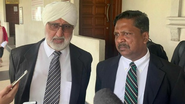 Jagjit Singh (left) and Akberdin Abdul Kader, lawyers representing North Korean national Mun Chol Myong, speak to reporters after a hearing in Mun's case at the Kuala Lumpur Court Complex. Sept. 20, 2019.