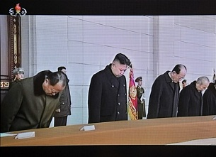 In an image from North Korean state TV, Kim Jong Un pays his respects to his father and predecessor Kim Jong Il at the Kumsusan Palace in Pyongyang, Dec. 17, 2012.