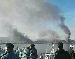 Smoke billows from Yeonpyeong Island on Tuesday after North Korean artillery shells struck it.