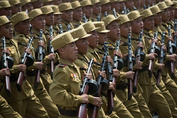 North Korean soldiers march in a military parade through Kim Il Sung square in Pyongyang marking the anniversary of the Korean War armistice, July 27, 2013.