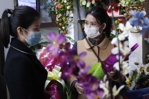 A woman shops for flowers on Mother's Day, Monday, Nov., 16, 2020, in Pyongyang, North Korea.