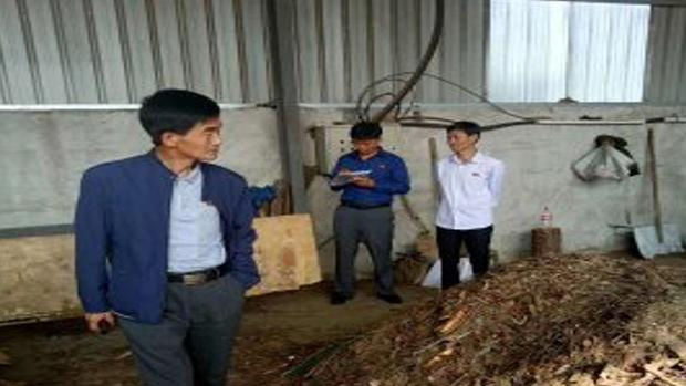 North Korean trade executives and workers discuss the import of production facilities by visiting a pig feed production plant in Dandong, China in an undated photo.