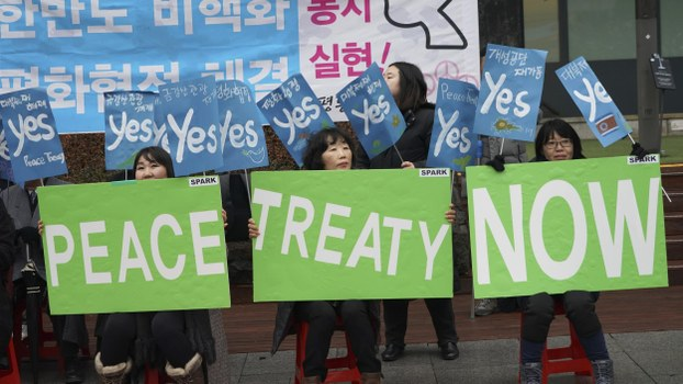 South Korean protesters hold signs during a rally to demand the peace on the Korean peninsula and to stop sanctions on North Korea, in Seoul, South Korea, Tuesday, Dec. 17, 2019.