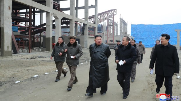 This undated picture released from North Korea's official Korean Central News Agency (KCNA) on January 7, 2020 shows North Korean leader Kim Jong Un (C) visiting the construction site of the Sunchon phosphatic fertiliser factory in South Pyongan province.