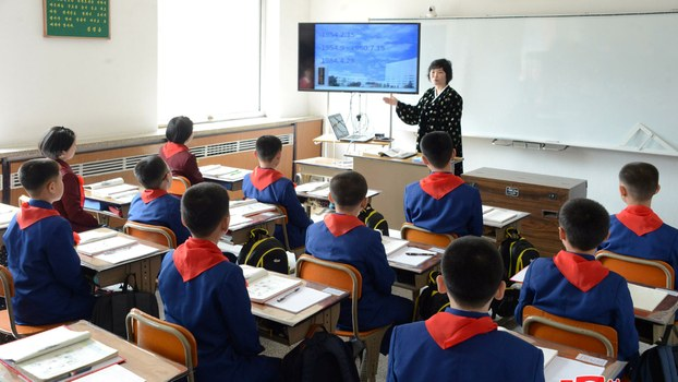 Students attend a class as the new school year begins in North Korea in this photo released by Korean Central News Agency (KCNA) April 2, 2018.