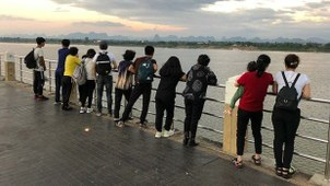 Thirteen North Korean defectors who safely arrived in Thailand peer across the Mekong river into Laos. They crossed the river from Laos into Thailand October 18, 2019.