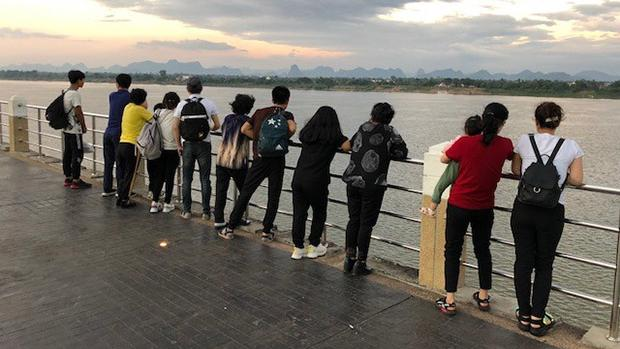 Thirteen North Koreans peer across the Mekong river, after arriving in Southeast Asia October 18, 2019.