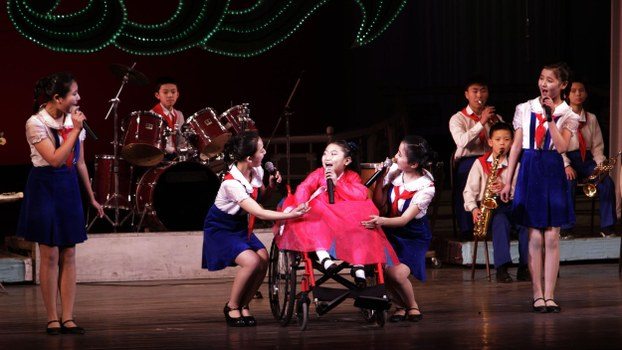A disabled child, center, sings with schoolchildren at a performance at the Mangyongdae Schoolchildren's Palace in Pyongyang, North Korea, on Monday, Dec. 3, 2012. The performance was held in honor of the International Day of Persons with Disabilities.