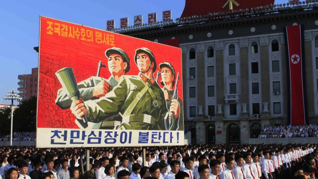 Tens of thousands of North Koreans gathered for a rally at Kim Il Sung Square carrying placards and propaganda slogans as a show of support for their rejection of the United Nations' latest round of sanctions on Wednesday Aug. 9, 2017, in Pyongyang, North Korea.