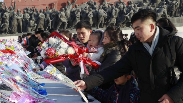 People visit the Mansudae Grand Monument to lay flowers at the feet of the bronze statues of their late leaders Kim Il Sung and Kim Jong Il in Pyongyang, North Korea Wednesday, Jan. 1, 2020.