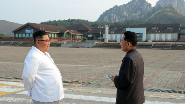 This undated picture released from North Korea's official Korean Central News Agency (KCNA) on October 23, 2019 shows North Korean leader Kim Jong Un (left) inspecting the Mount Kumgang tourist area.