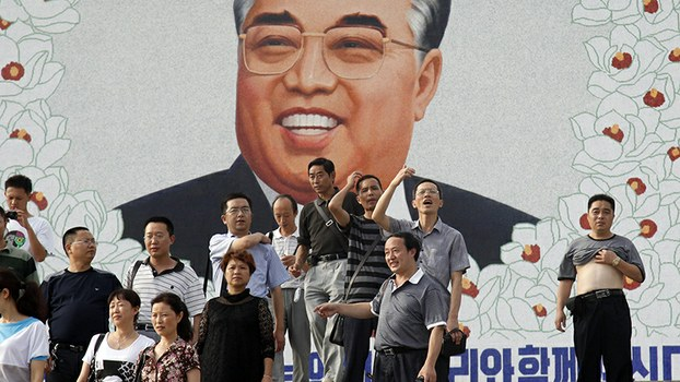 Chinese tourists gather to take photos in front of a portrait of late North Korean leader Kim Il Sung at a theater in Rason, North Korea in a file photo.