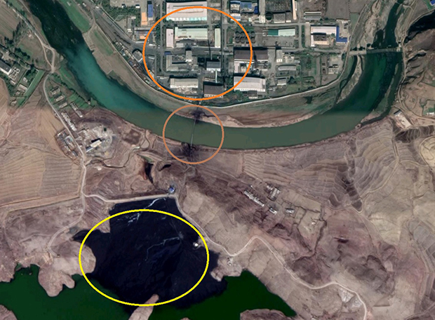 North Korea's Pyongsan uranium mill (top circle), a pipe for waste transportation (center circle), and a reservoir with waste.