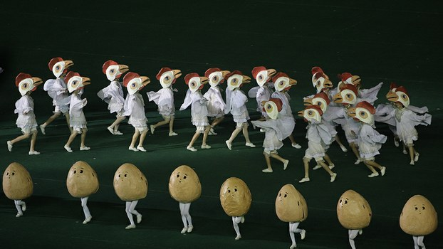 "North Koreans, dressed as chickens and eggs, dance at a stadium in Pyongyang, North Korea, during a ""mass games"" performance to celebrate agricultural self reliance in a file photo."