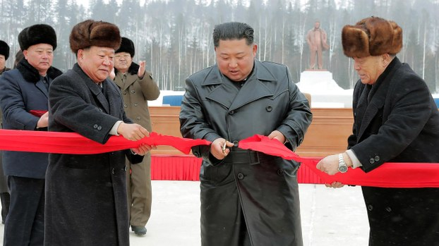 This picture taken on December 2, 2019 and released from North Korea's official Korean Central News Agency (KCNA) on December 3, 2019 shows North Korean leader Kim Jong Un (2nd R) cutting a ribon to mark the completion of the construction of the township of Samjiyon county.