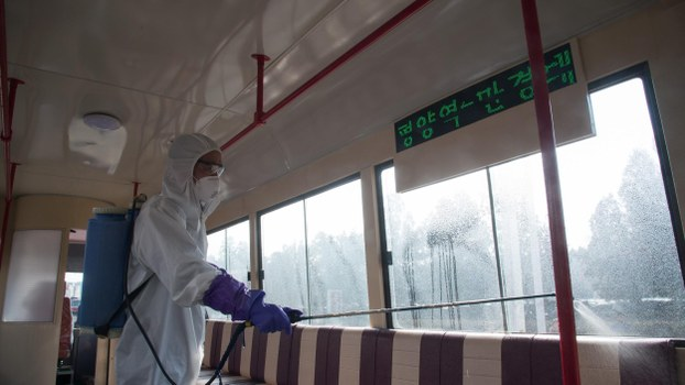 An official from the Mangyongdae District emergency anti-epidemic headquarters disinfects a tramcar to prevent the spread of the COVID-19 coronavirus, at the Songsan Tram Station in Pyongyang on February 26, 2020.