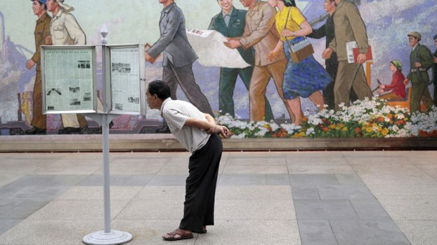 A man reads newspapers at a subway station in Pyongyang, North Korea, Wednesday, Sept. 11, 2019.