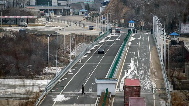 A truck entering the Rason Special Economic Zone makes its way across a bridge marking the border between North Korea (bottom) and China (top), Nov. 21, 2017.