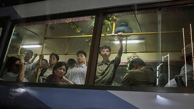 North Korean commuters ride a public bus during evening rush hour in Pyongyang, Sept. 28, 2016.