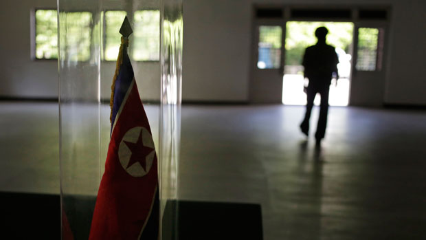 A North Korean soldier stands silhouetted at the entrance to the armistice museum in Panmunjom, June 20, 2018.