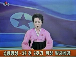 A North Korean announcer reads a statement on the rocket launch in a screen grab from state television, Dec. 12, 2012.