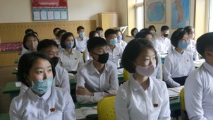 Students wearing face masks take a class at the Ryongwang Senior Middle School in Pyongyang, North Korea, Wednesday, June 3, 2020.