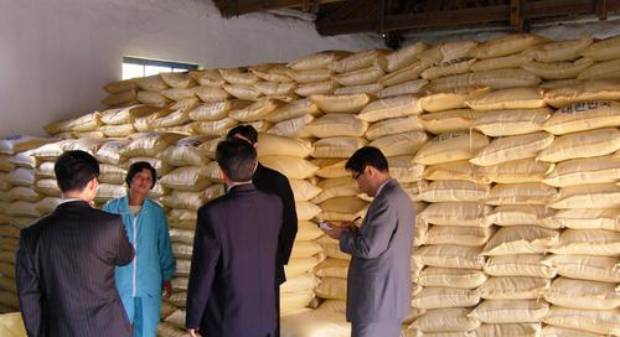 This file photo shows rice piled up to be distributed to residents at a food supply center in Kaesong, North Korea.