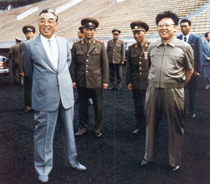 This handout picture taken on an undisclosed date in 1992 shows the current North Korean leader Kim Jong-Il (R) and then-leader, Jong-il's father, Kim Il-Sung (L) inspecting a soccer ground in Pyongyang.