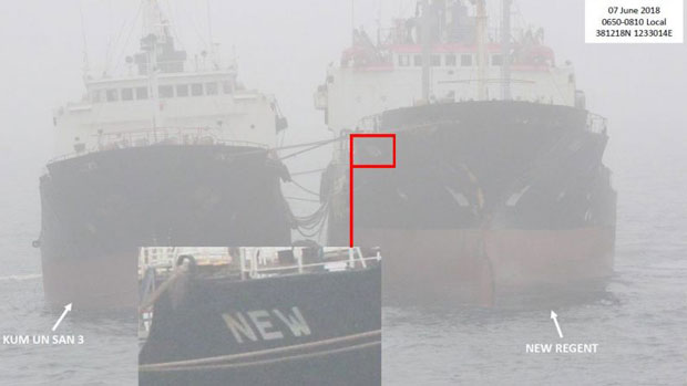 An illicit fuel transfer to a North Korean vessel at sea is shown in a State Department photo, June 7, 2018.