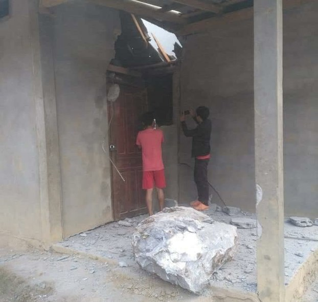 A large rock crashed through the roof of a house in Phonemany village, Luang Prabang province, Laos, following a rock-blasting accident at a nearby cement factory on October 5, 2019.