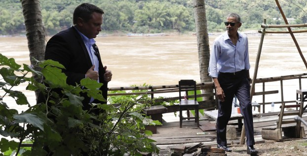 With a member of his secret service detail accompanying, U.S. President Barack Obama walks near the Mekong River in the Luang Prabang, Laos, Wednesday, Sept. 7, 2016.