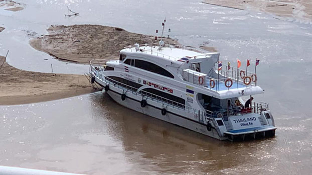 In a file photo, a Thai boat on the Mekong river struggles with low water levels.