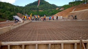 This 2020 file photo shows an access road to the future site of the Luangprabang dam under construction in Luang Prabang province, Laos.