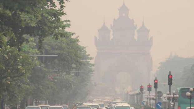 Smog covers the streets of Vientiane, Laos in April, 2019.
