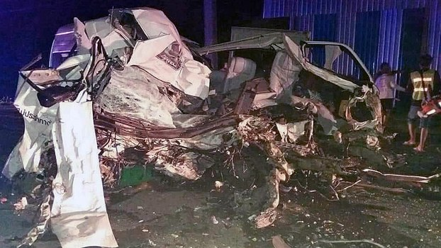 The wreckage of a van carrying Lao migrant workers lies in a heap after crashing into a tractor-trailer in eastern Thailand's Sa Kaeo province, Aug. 18, 2019.