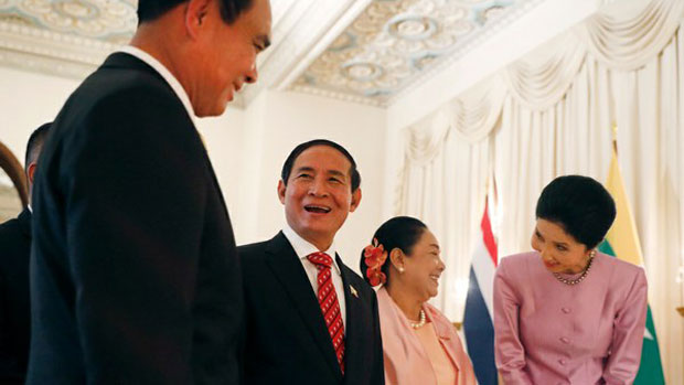 Thai Prime Minister Prayuth Chan-o-cha (left), speaks to Myanmar President Win Myin, as Myanmar first lady Cho Cho (third from left), talks to Prayuth's wife, Naraporn Chan-o-cha, at the Government House in Bangkok, June 14, 2018.