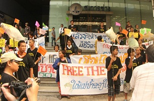 Activists protest the Xayaburi dam in front of the Ch. Karnchang headquarters in Bangkok, April 24, 2012.