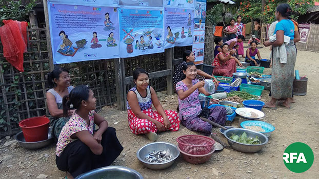 Myanmar women gather to prepare fresh food in Minbya township, western Myanmar's Rakhine state, in an undated photo.