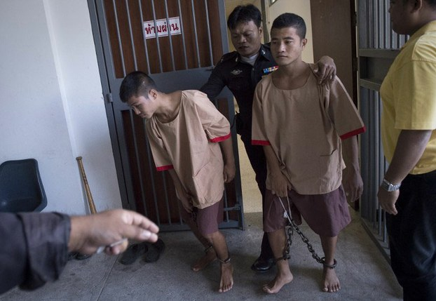 Zaw Lin (left) and Win Zaw Htun are taken from court after hearing their sentences, Koh Samui, Thailand, Dec. 24, 2015.