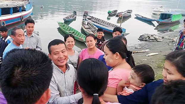 Chin state lawmaker Whay Tin (C) greets well-wishers after he is released by the Arakan Army and returns to western Myanmar's Chin state, Jan. 21, 2020.