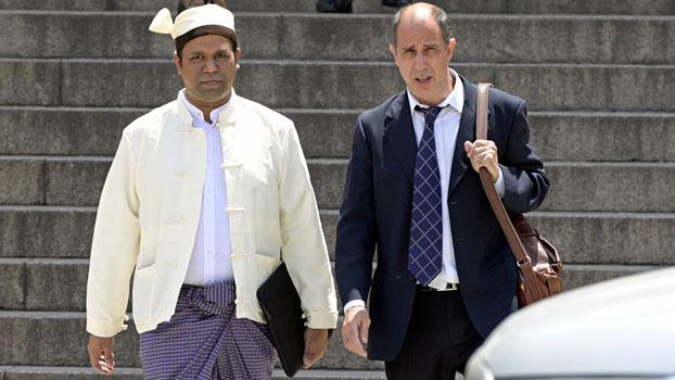 Tun Khin (L), president the Burmese Rohingya Organisation UK, and Argentine human rights lawyer Tomas Ojea Quintana (R) leave Argentine federal court in Buenos Aires after filing a lawsuit against Myanmar's Aung San Suu Kyi and others for crimes against the Rohingya, Nov. 13, 2019.
