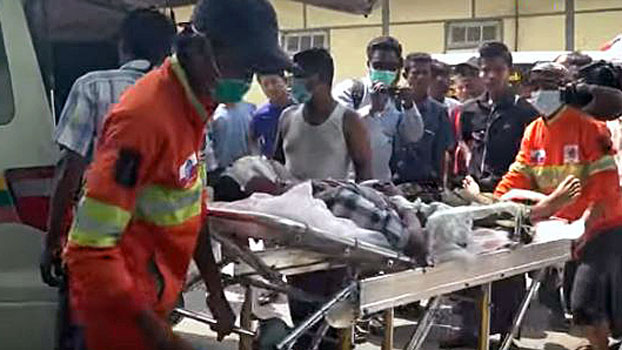 Medics transfer a civilian injured by heavy shelling in Kyauk Seik village to a hospital in Ponnagyun township, western Myanmar's Rakhine state, April 13, 2020.