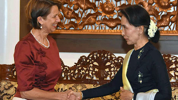 Christine Schraner Burgener (L), the UN secretary-general's special envoy for Myanmar, greets Myanmar State Counselor Aung San Suu Kyi (R) in Naypyidaw, June 20, 2018.